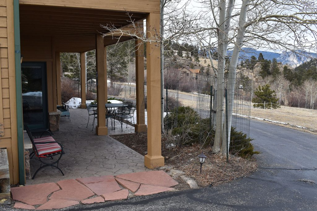 Photo taken from private parking location and entry door for your beautiful stay in Estes Park