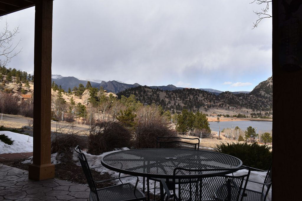View outside on private patio with table seating for 4 and view of Marys Lake