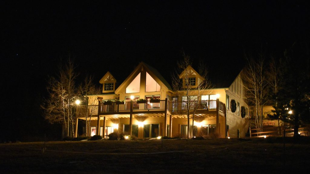 Outside nighttime view of our wonderful home, guests located on main floor