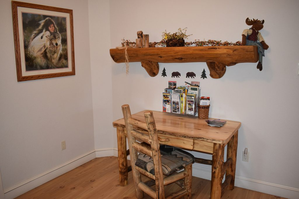 Rustic Wood Desk and chair with wood beam shelf above