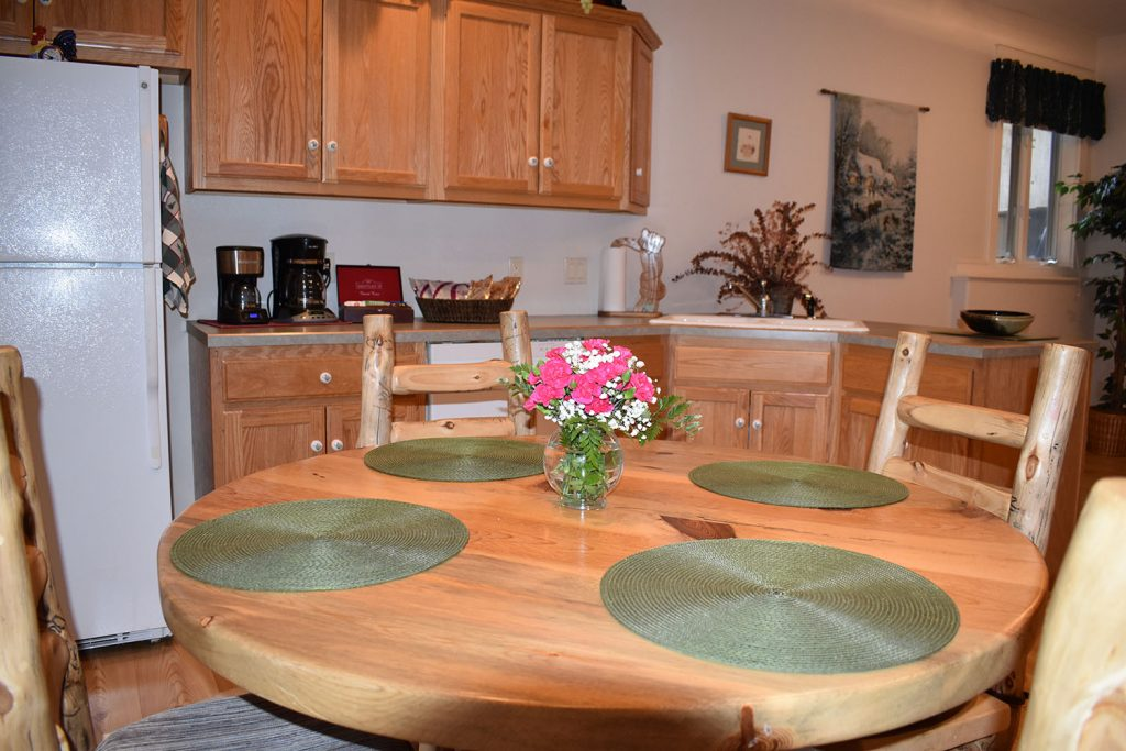 Kitchen with full size refrigerator, coffee and tea options seating for 4